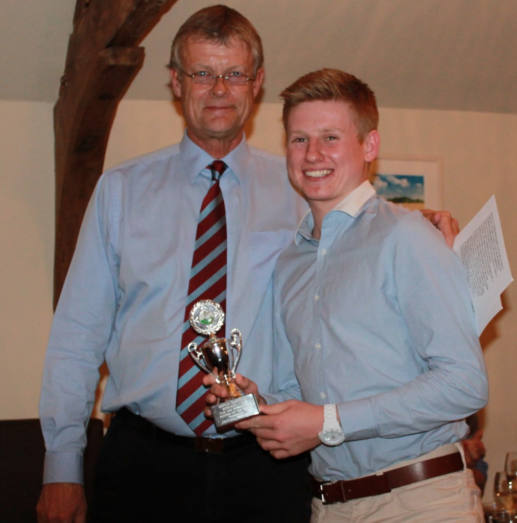 Callum Taylor receives the Neville Herathge Trophy for most outstanding youth player from club captain Peter Thomas