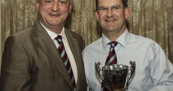 Kevin Cooper picks up the Swardeston CEYMS player of the year from captain Stuart Bartram.