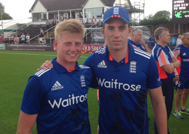 Callum Taylor, left, celebrates the drawn series with Australia after helping England Under-19s win the final one-day match of the series at Worcestershire, pictured with team-mate Dan Lawrence. Picture: ECB