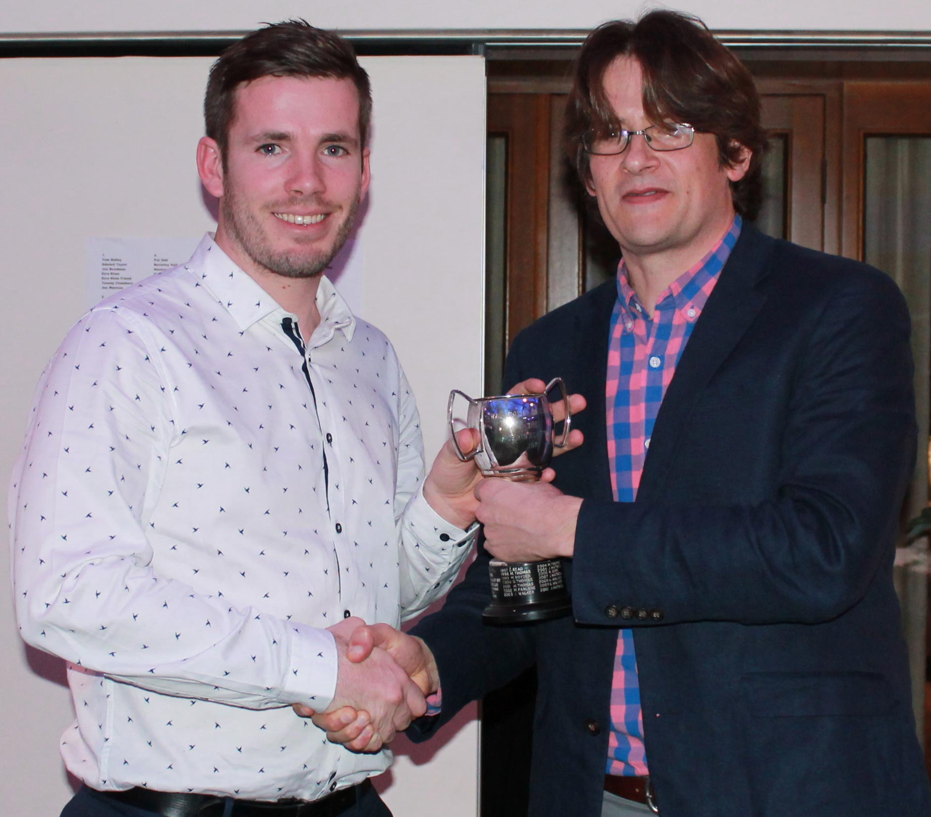 Mark Thomas presents Joe Gatting with the Chris Bean Cup for the Premier XI player of the year.