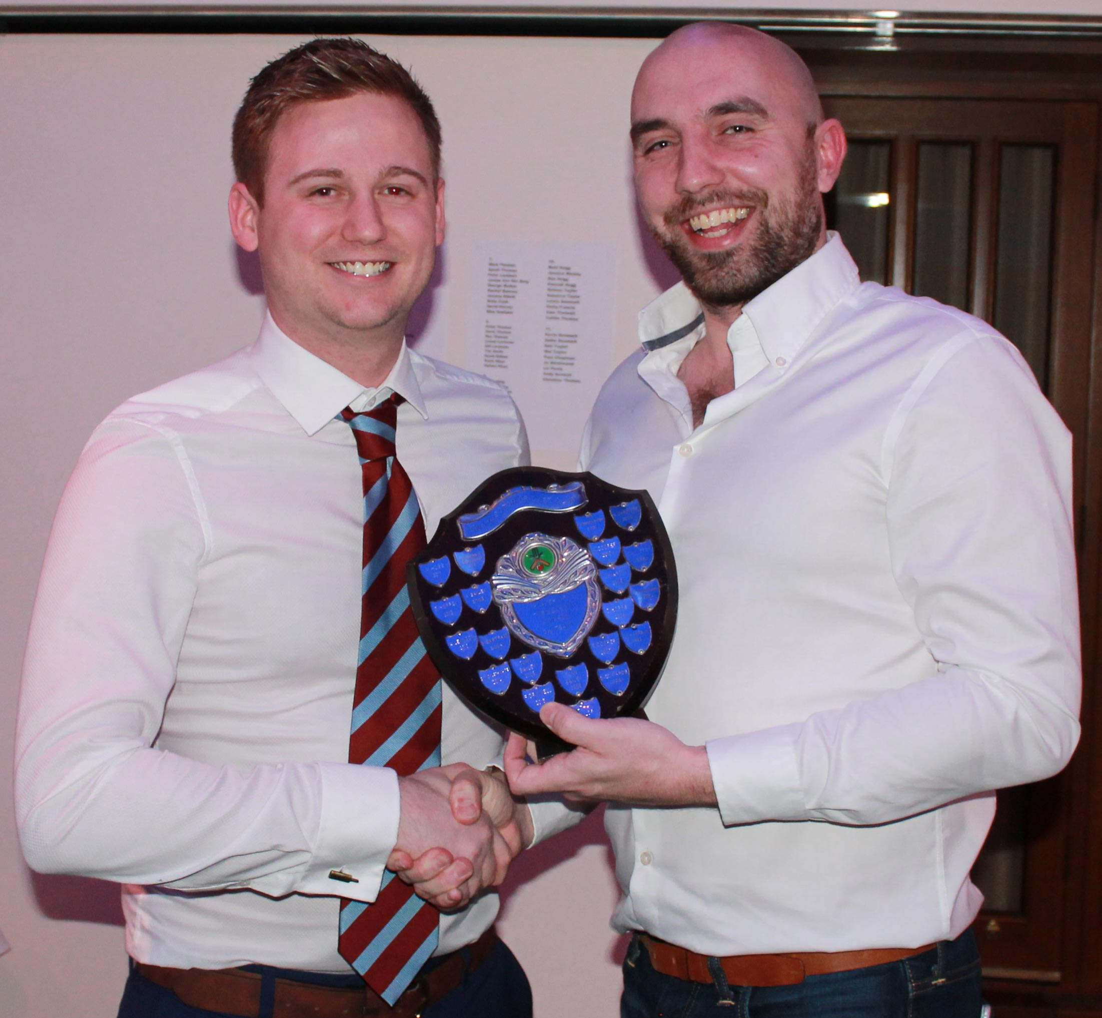 Matt Hogg presents Nathan Taylor with the Bob Read Shield for A XI player of the year.