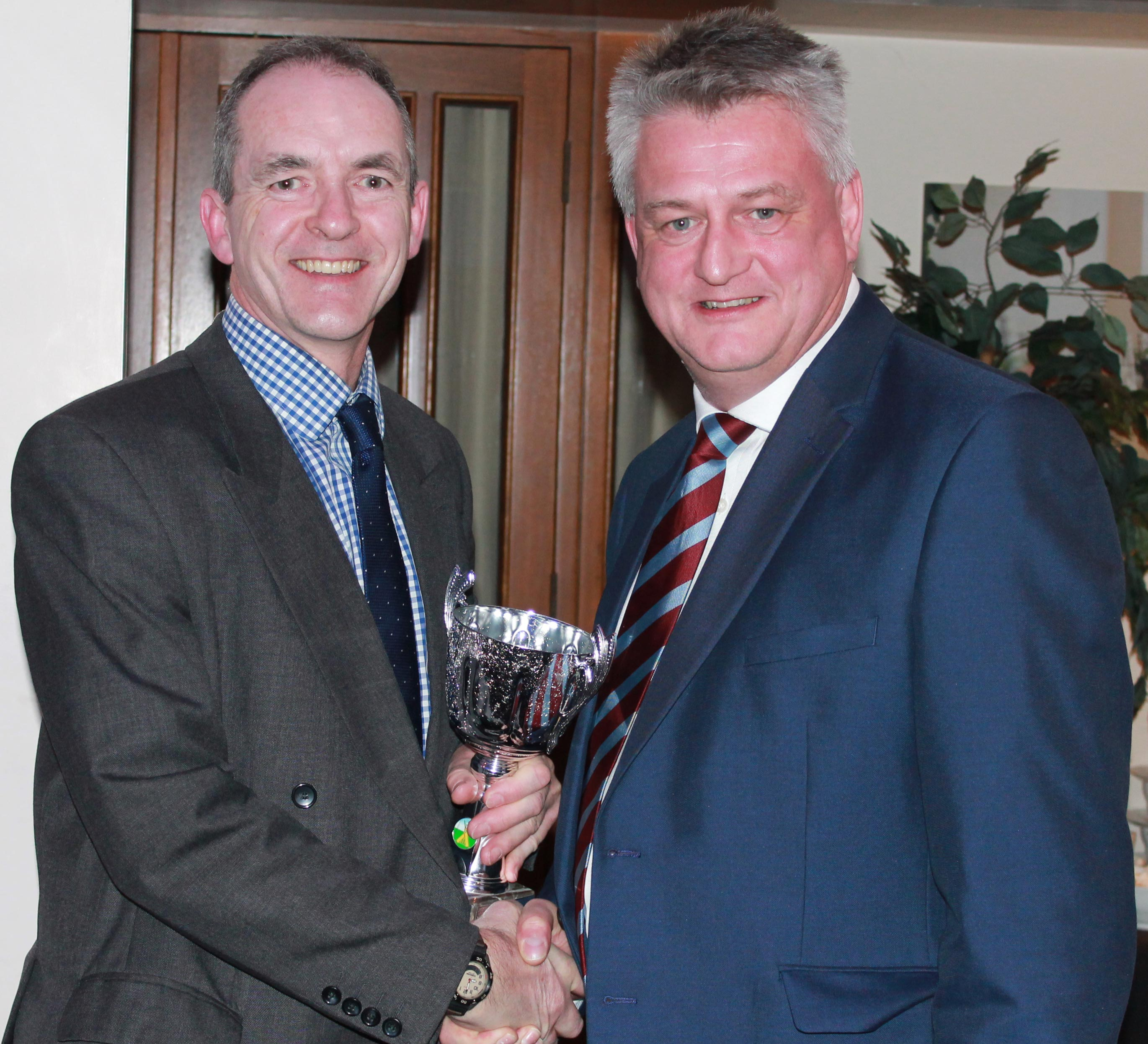 Stuart Bartram presents Tim Smith with the CEYMS Trophy for the Swardeston CEYMS player of the year. Tim was receiving the trophy on behalf of his son Eddie.