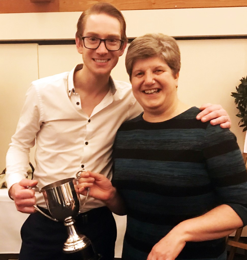 Gill Levinson picks up the Peter Thomas Trophy on behalf of her son Alex from captain Sam Thelwell as Swardeston Sunday player of the year.