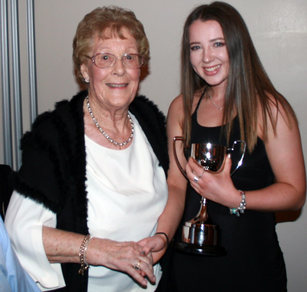 Beth Harmer picks up the inaugural Womens' player of The Year award and receives the Rosamond Thomas Trophy from our club president Ros Thomas.