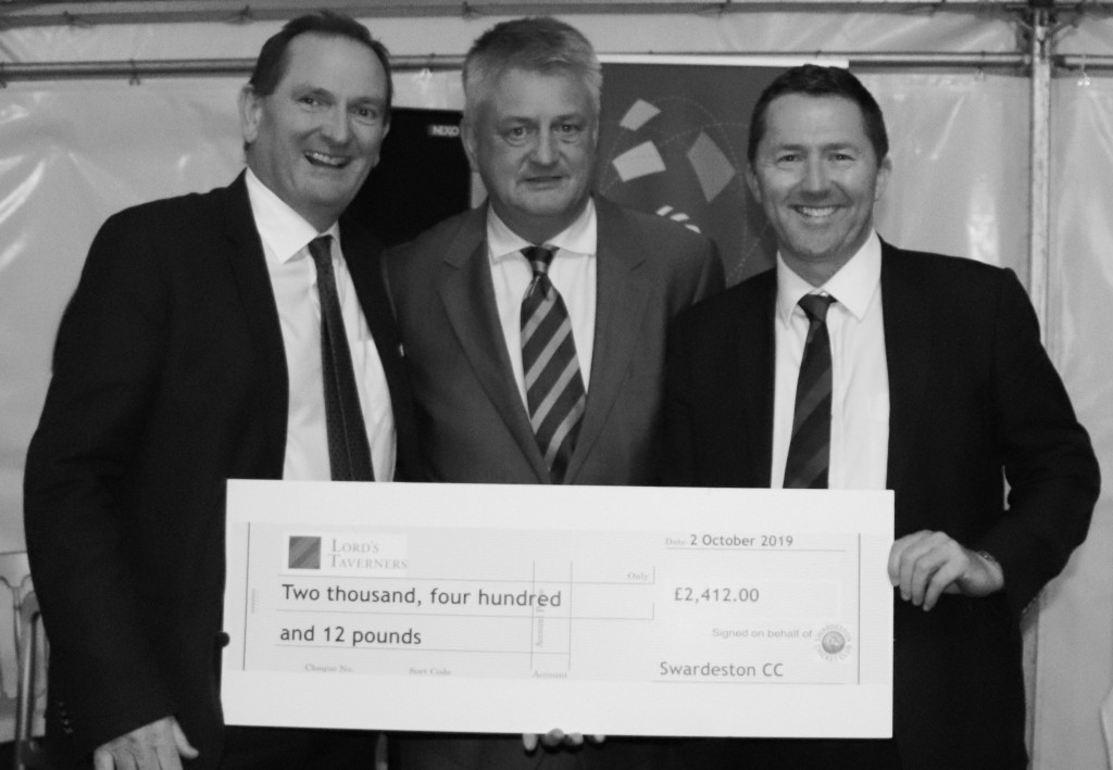 Swardeston chriman Stuart Bartram, centre, hands over a cheque for £2,412 to Jon Hook, right, of Norfolk Lord's Taverners. Watching is Peter Davies, left, chairman of Swardeston dinner sponsor Breakwater IT.